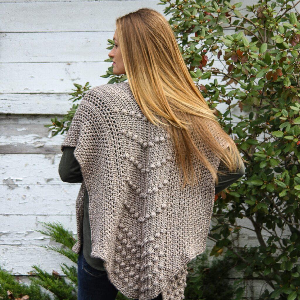 A crochet ruana project made in worsted heartland yarn.