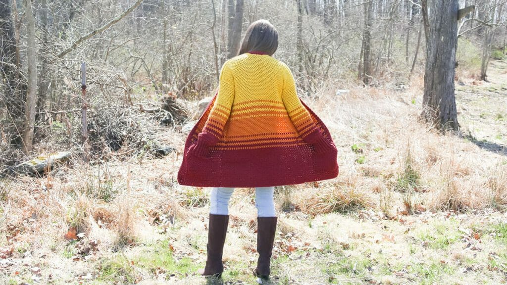 A cozy crochet sweater with pockets.