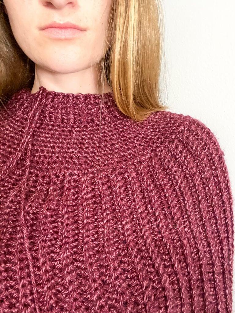 Close up of crochet poncho yoke.