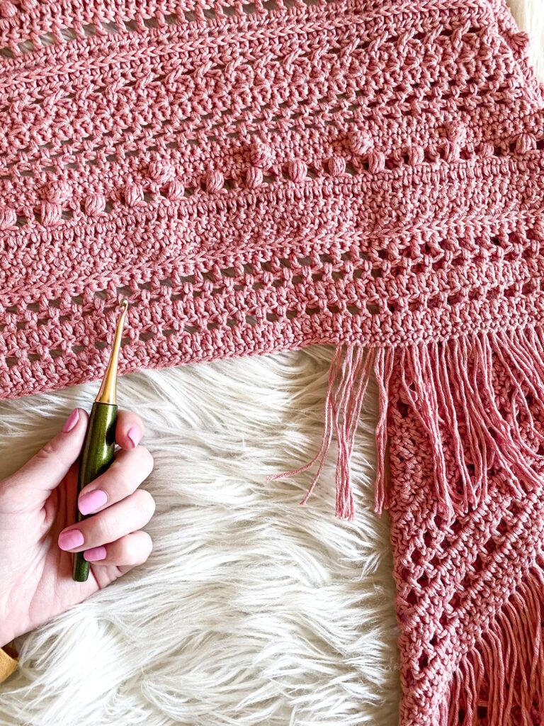 Adding fringe to your crochet sampler shawl.
